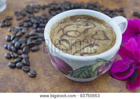 Artisan Coffee On A Brown Wooden Table With Flowers