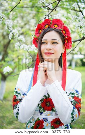 Dreamy Girl In National Clothes In A Flowering Garden
