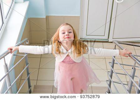 Younger Schoolgirl On Stairway