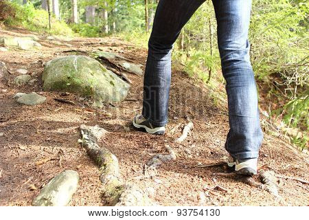 Hiking Boots And Legs Of A Woman On The Mountain Path