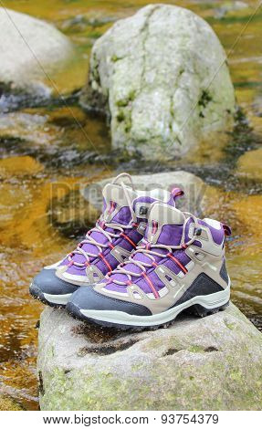 Hiking Boots Over A Mountain Stream