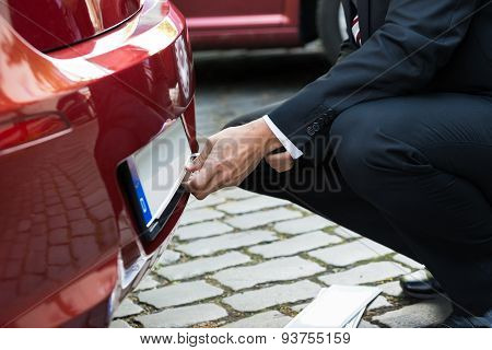 Man Holding Empty White Number Plate