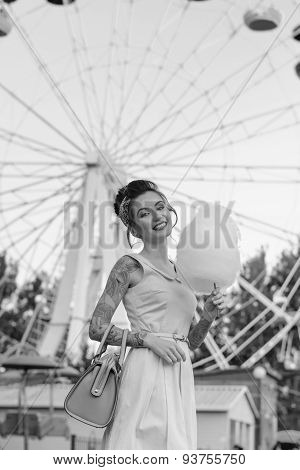 Stylish girl in an amusement park