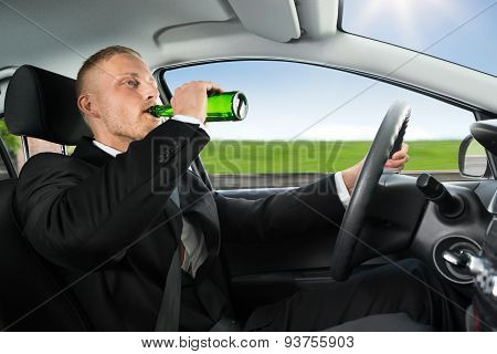 Man Drink's Beer While Driving Car