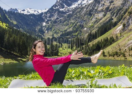 Woman Doing Boat Pose Outdoors