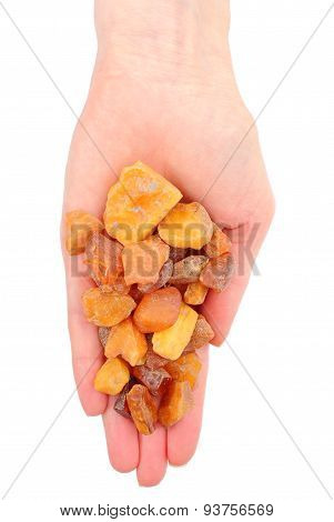 Hand Of Woman With Raw Ambers On White Background