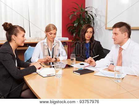 Businesspeople working together at meeting table in office