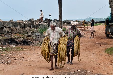 Fishermen With A Rope For Fishing Net On Samudra Beach In Kovalam