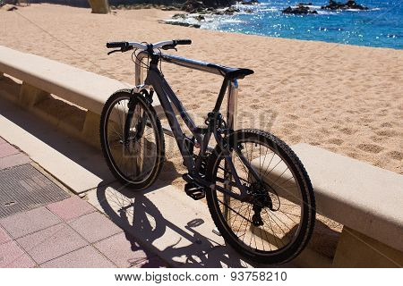 Bicycle standing near the beach. Ecological tourism. Summer sea view