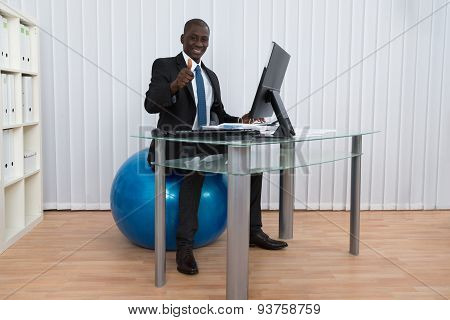 Businessman Working Sitting On Pilates Ball