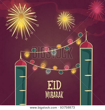 Beautiful mosque design decorated with colorful lights on firecrackers decorated background for Islamic festival, Eid celebration.