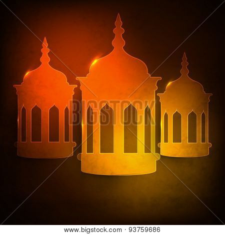 Glowing traditional lanterns on grungy brown background for Islamic holy month of prayers, Ramadan Kareem celebration.