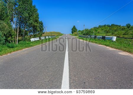 Rural Road Through A Forest