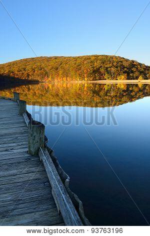 Dock at Mountain Lake in Autumn