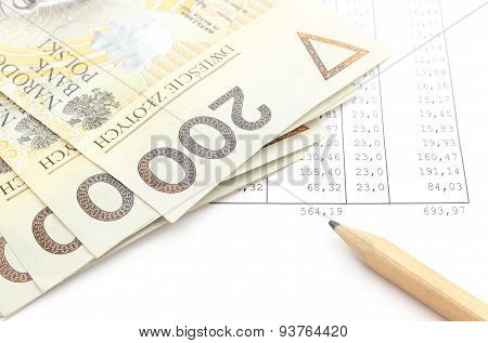 Money And Pencil Lying On Spreadsheet