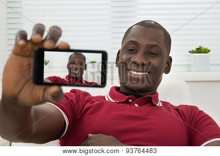 Young African Man Taking Selfie