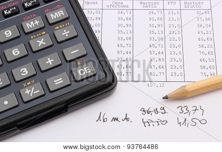 Calculator And Pencil Lying On Spreadsheet