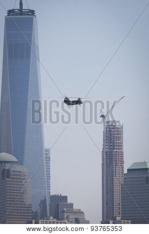 JERSEY CITY, NJ - MAY 26 2015: A US Marine Corps helicopter flies past the Freedom Tower and WFC on the Upper New York Bay before the USS San Antonio departs Pier 92 at the end of Fleet Week NY 2015.
