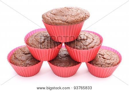 Stack Of Fresh Baked Chocolate Muffin In Red Silicone Cup