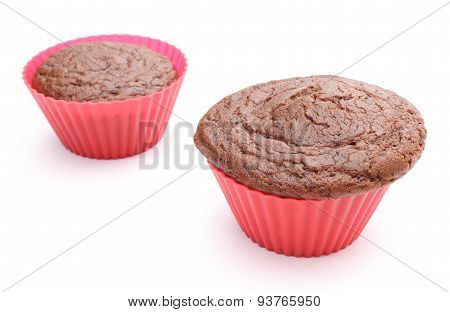 Fresh Baked Chocolate Muffin In Red Silicone Cups