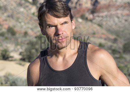 Portrait Of Adventurous Outdoorsman In The Desert