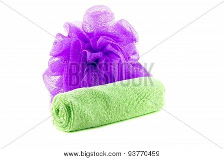 A roll of green towel with purple sponge