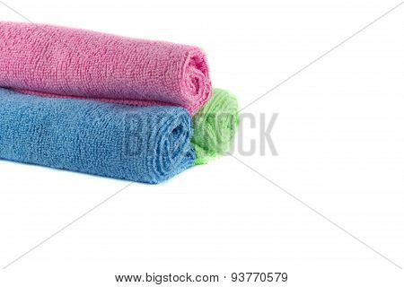 A roll of green, blue and pink towels