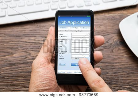 Person Hands Filling Job Application On Mobile Phone