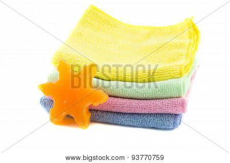 A stack of colorful towels and soap in the shape of a star-shape