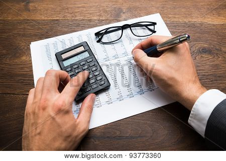 Businessman Calculating Financial Sheet