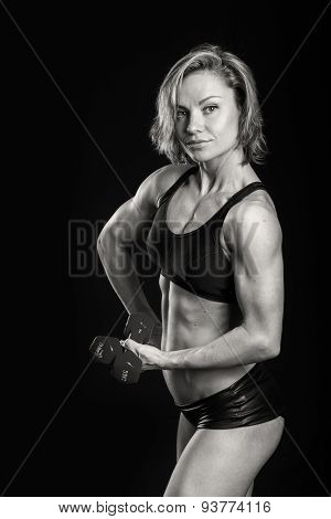 Strong, sexy girl posing on black.
