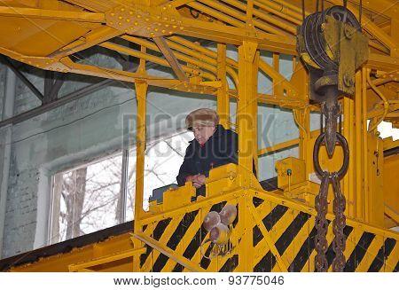 Druzhkovka, Ukraine - December 25, 2012: The Woman - A Crane Operator In The Workplace. Antratsitovs