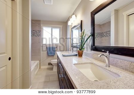 Beautiful Bathroom With Tile Floor.