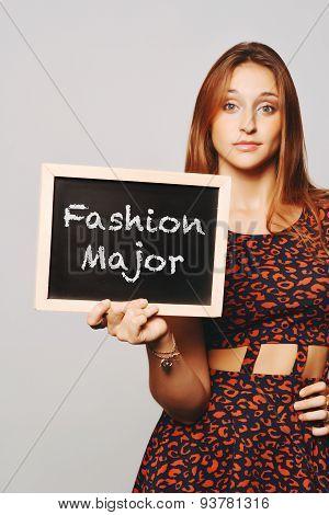 University College Student Holding A Chalkboard Saying Fashion Major