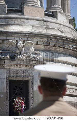 NEW YORK - MAY 25 2015: The words In Memoriam carved into the marble of the Soldiers and Sailors Monument in Manhattan with a US Marine in the foreground on Memorial Day during Fleet Week 2015.