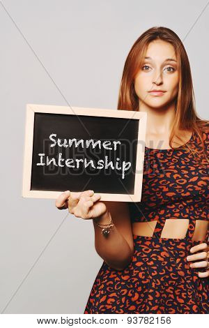 University College Student Holding A Chalkboard Saying Summer Internship