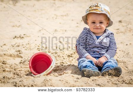 Boy in a sandpit