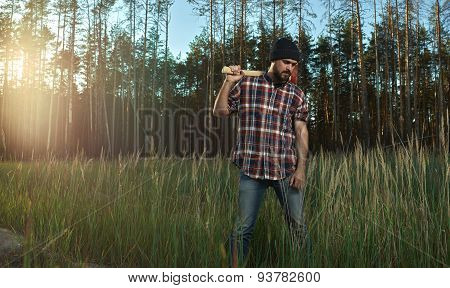 Bearded Lumberjack In Hat Holding A Big Axe On Shoulder