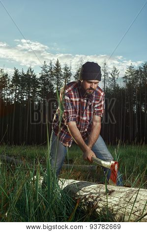 Woodcutter With Beard, Hat And Shirt Cut A Tree