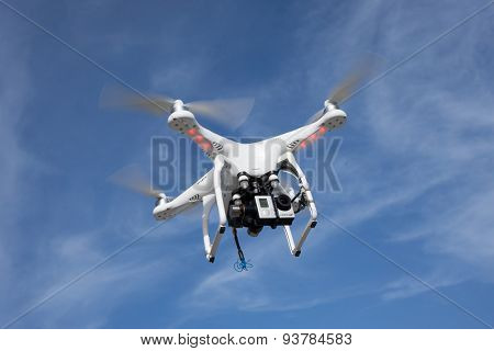 JACKSONVILLE, FL. USA - JUNE 14, 2015: A DJI Phantom consumer drone flying in the sky with a GoPro Hero 3 action camera. The global market for consumer drones is forecast to top $300 million by 2018.