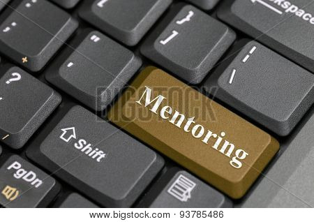 Brown mentoring key on keyboard