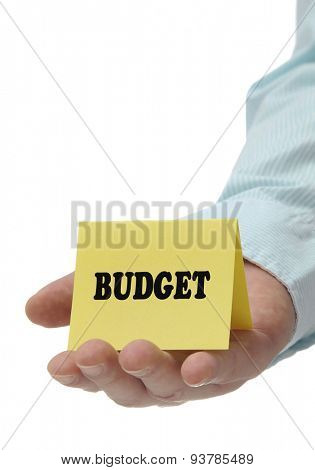 Business man holding yellow budget sign on hand