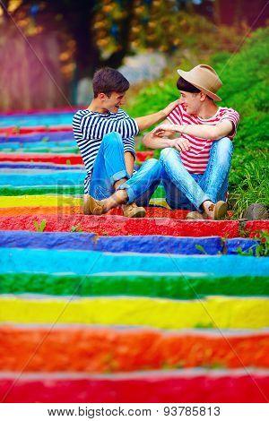 Happy Male Couple Having Fun On Rainbow Stairs