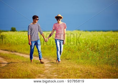 Two Boys In Love Walking Together On Summer Field
