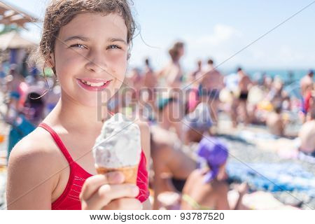 girl with ice-cream cone on the beach
