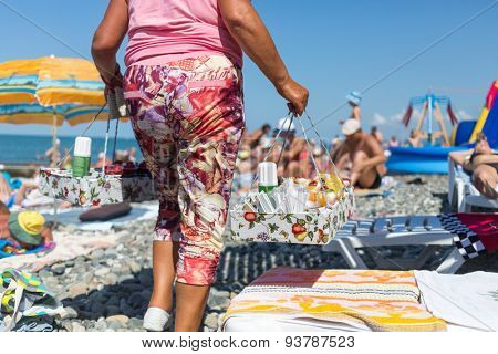 seller of fruit salads on the beach