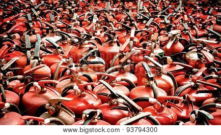 The fire extinguisher used. background with a lot of fire extinguishers