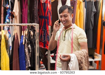 Asian man tailor phone call talking fashion clothes dress