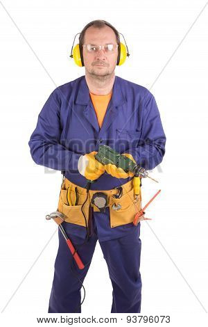 Worker in hard hat holding drill.