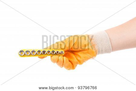 Hand in gloves holding nozzles for screwdriver.
